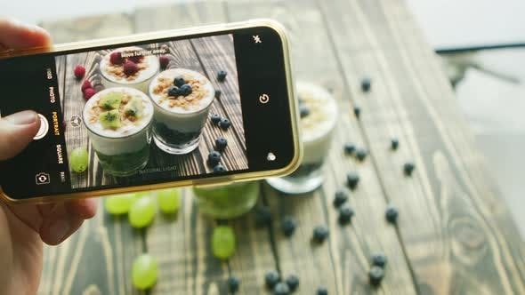 Thumbnail for Crop Hand Taking Photo of Fresh Desserts