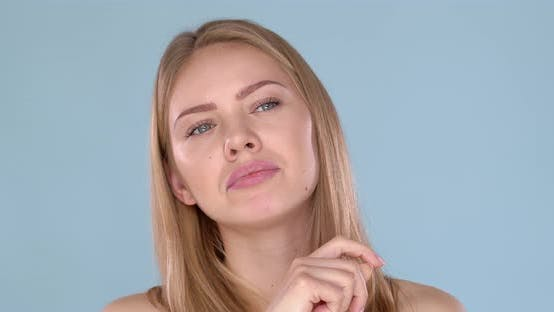 Potrait of Beautiful Blond Woman with Thinkful Face Expression