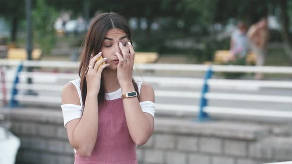 Thumbnail for Beautiful Girl Frowning, Fuming and Talking on Phone on Dnipro Quay in Slo-mo