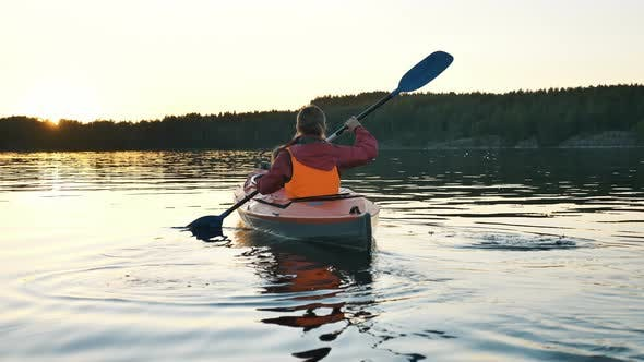 Thumbnail for Mother in Vest Rows Sports Kayak with Girl Along River