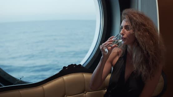 Thumbnail for Luxury Lifestyle - Woman Drinking Champagne. Elegant Lady Holding Wine Glass and Looking on Window