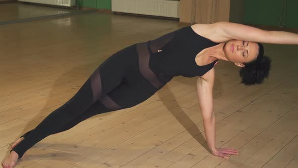 Thumbnail for Beautiful Woman Doing Yoga Indoors Stretching Her Body Elegantly