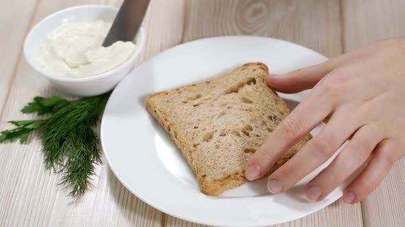 Thumbnail for Woman Spreads Curd Cheese on Cereal Bread