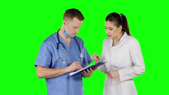 Thumbnail for Two Doctors Talking with Clipboard. Green Screen