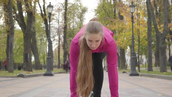 Thumbnail for Confident Young Caucasian Woman Looking Up and Starting Running. Attractive Female Runner Training
