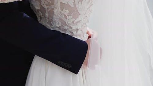 The Bride Hugs The Groom