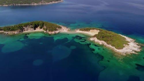 A Drone Flies Over a Tropical Island.