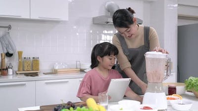 Mother and daughter make smoothie