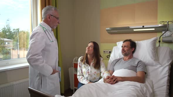 Thumbnail for Husband and Wife Communicating with Doctor in Ward