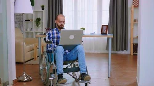 Handicapped Freelancer Working Remotely
