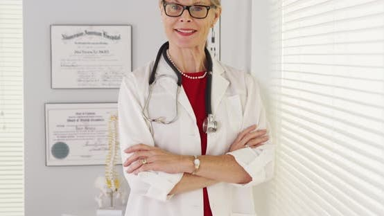 Thumbnail for Experienced woman doctor standing