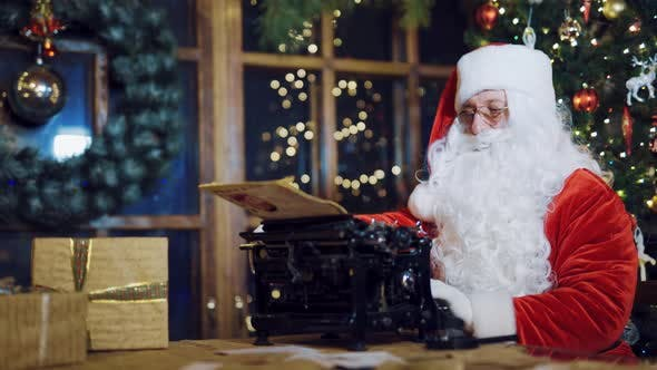 Santa Claus Writing Letters on the Typewriter