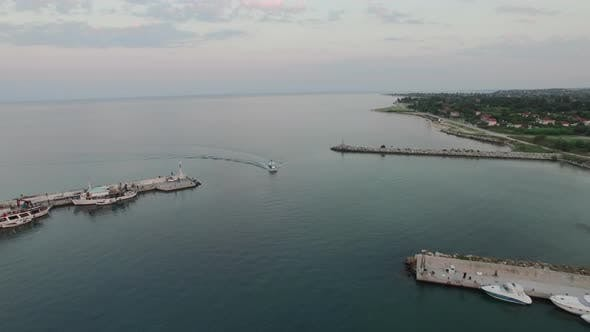 Thumbnail for Aerial Shot of the Quay and Sailing Motor Boat