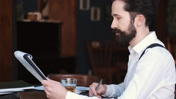 Thumbnail for Stylish Businessman Working in a Cafe