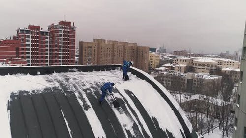 The Industrial Climbers Clear a Roof From the Accumulated Snow in Moscow