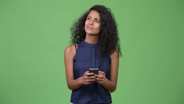 Thumbnail for Young Beautiful Hispanic Businesswoman Thinking While Using Phone