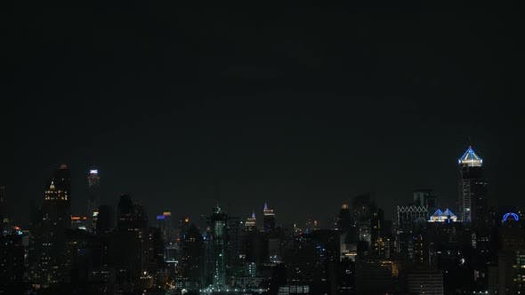 Flash of lightning over night city