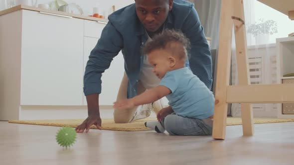 Thumbnail for Father Playing with Child on the Floor