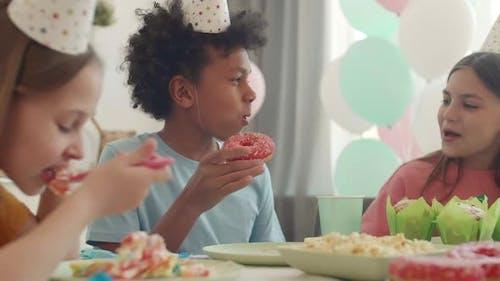 School Boy Eating Doughnut