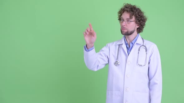 Thumbnail for Happy Young Bearded Man Doctor Touching Something and Giving Thumbs Up