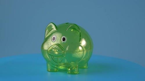 Transparent green piggy bank rotated