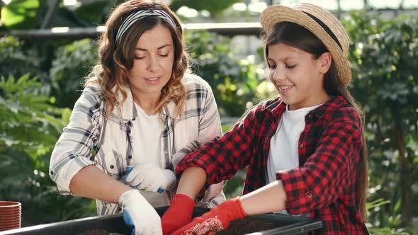 Thumbnail for Mother and Daughter Gardening in a Plantation