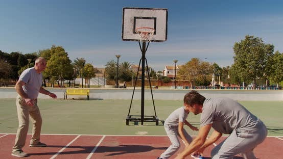 Thumbnail for Multi-generation Family Playing Basketball on Outdoor Court