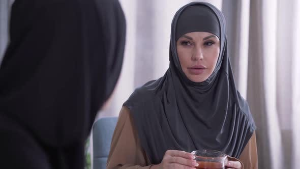 Thumbnail for Close-up Portrait of Modern Muslim Woman on Hijab Listening To Unrecognizable Friend