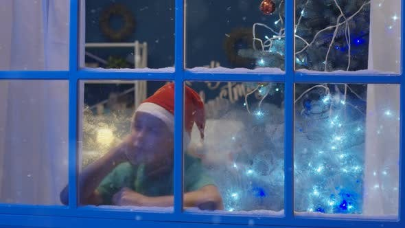 Thumbnail for Sleepy Dreaming Boy Looking in Window in Christmas Time