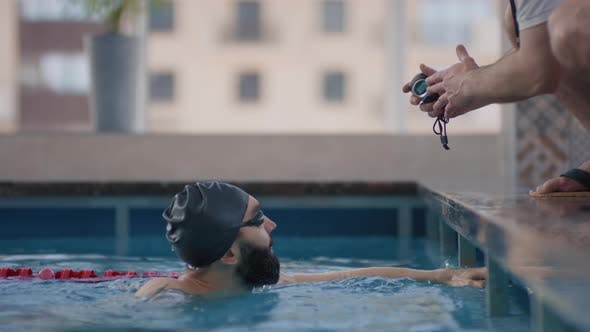 Slowmo of Swimmer Talking to Coach during Practice