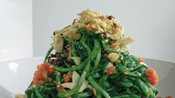 Rolling Zucchini Noodles Dish. Restaurant Food Side View Closeup
