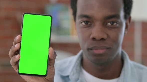 Thumbnail for African Man Holding Green Chroma Key Smartphone