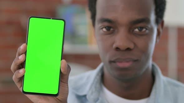 African Man Holding Green Chroma Key Smartphone