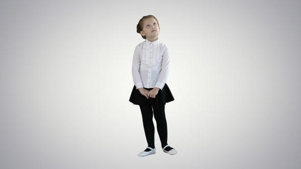 Thumbnail for Cute preschool girl standing being shy looking around and