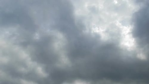 Gray Rain Clouds Are Moving in the Sky. TimeLapse