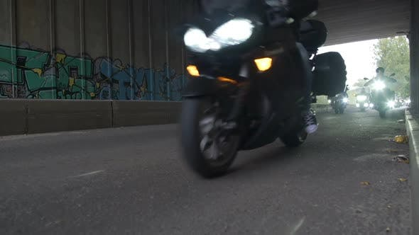 Thumbnail for Large Group of Motorcyclists Driving Under a Bridge with Working Headlights