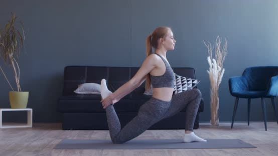Thumbnail for Young Woman Stretching Her Legs, Practicing Pilates at Home