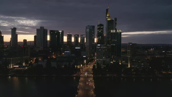 Wide Establishing Shot of Frankfurt Am Main, Germany Skyline at Night Over Main River and