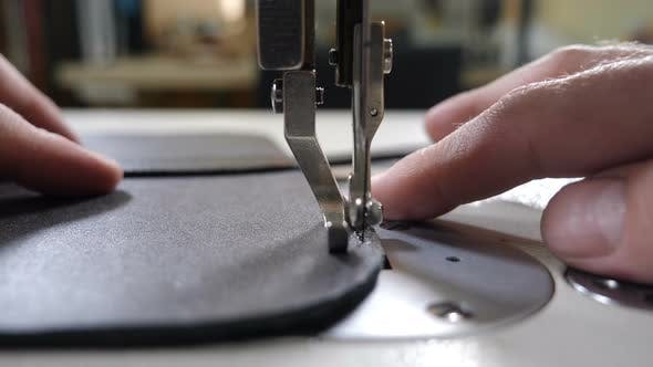 Craft Leather Workshop and Manufacture. Close-up of Master Sewing Pieces of Leather, Stitches Straps