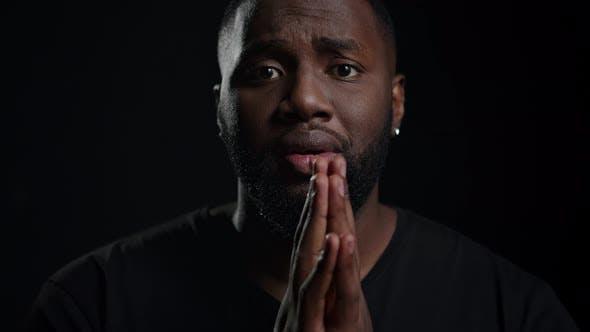 African American Man Begging Indoors