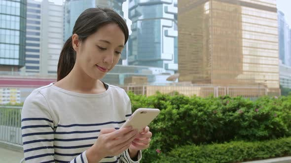 Woman use of cellphone at central of Hong Kong