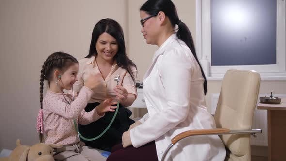 Thumbnail for Joyful Child Listening To Doctor with Stethoscope