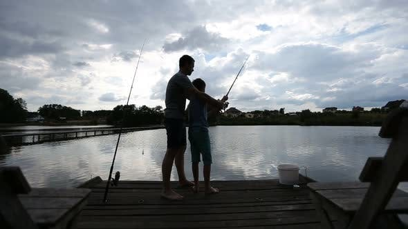 Thumbnail for Teenage Boy Learning To Fish with Fishing Rod