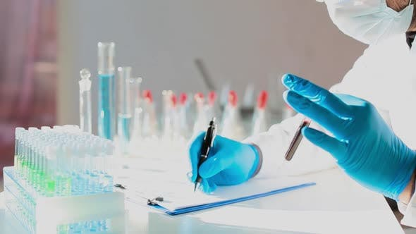 Cover Image for Close Up Footage of Blood Sample in Researcher's Hands.