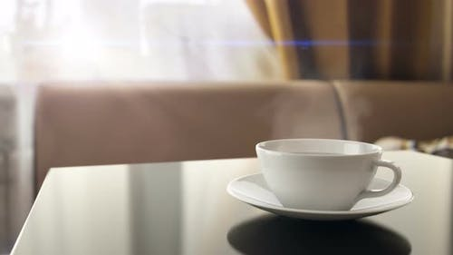 Breakfast with Cup of Hot Morning Coffee with Steam on the Kitchen Table at Home 4k