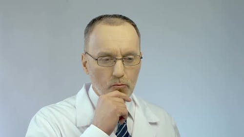 Emotions on Male Scientist's Face, Thinking on Project, Satisfied With Good Idea