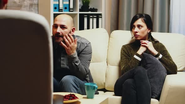 Thumbnail for Unhappy Young Woman with Husband at Couple Therapy