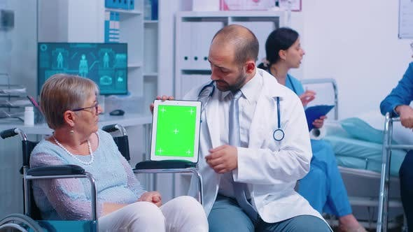 Thumbnail for Practitioner Holding Mock-up Tablet in Recovery Center for Elderly Disabled Patients