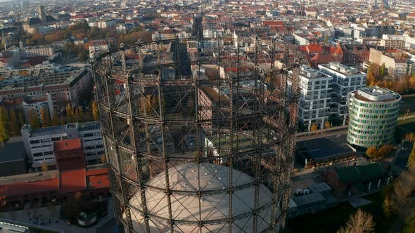 Thumbnail for Big Metal Structure Gasometer in Berlin, Germany, Aerial Tilt Down High Angle View
