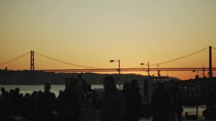 Silhouette of people watching sunset in the city port.